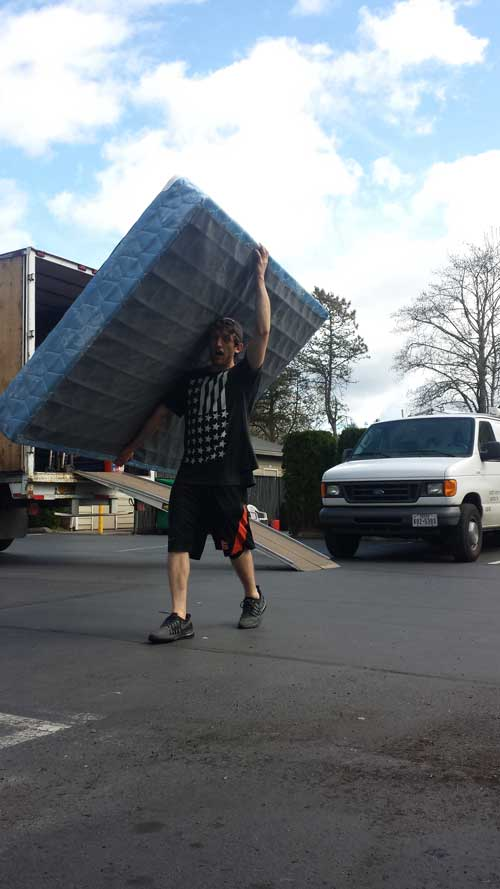 Priority mover carrying a mattress