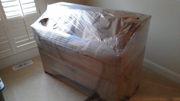 Securely Wrapped Piano for Move