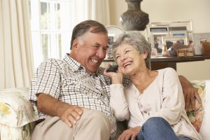 Retired Senior Couple Laughing Together Over the Phone