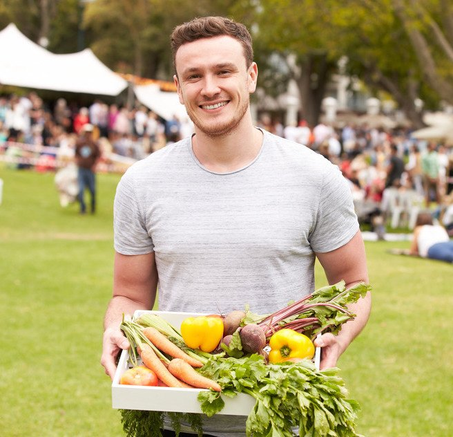 Handsome Man Carrying Fresh Produce Bought at Outdoor Farmers Market
