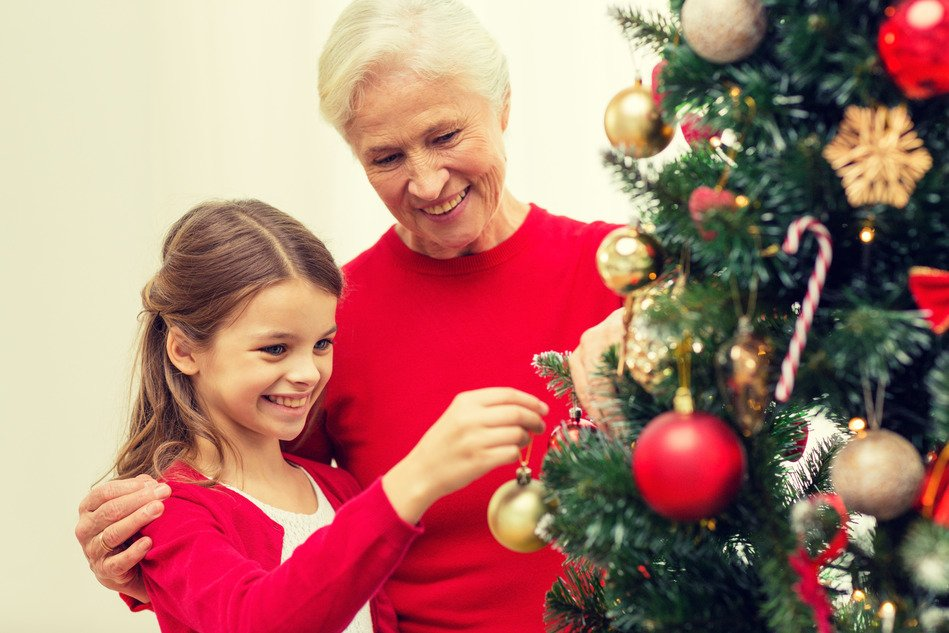 Grandmother and Niece Happily Hanging Tree Decorations