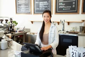 Female Coffee Shop Owner Planning a Business Move