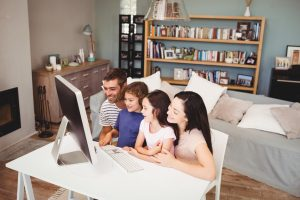 Family Researching the Best Moving Companies on their Computer