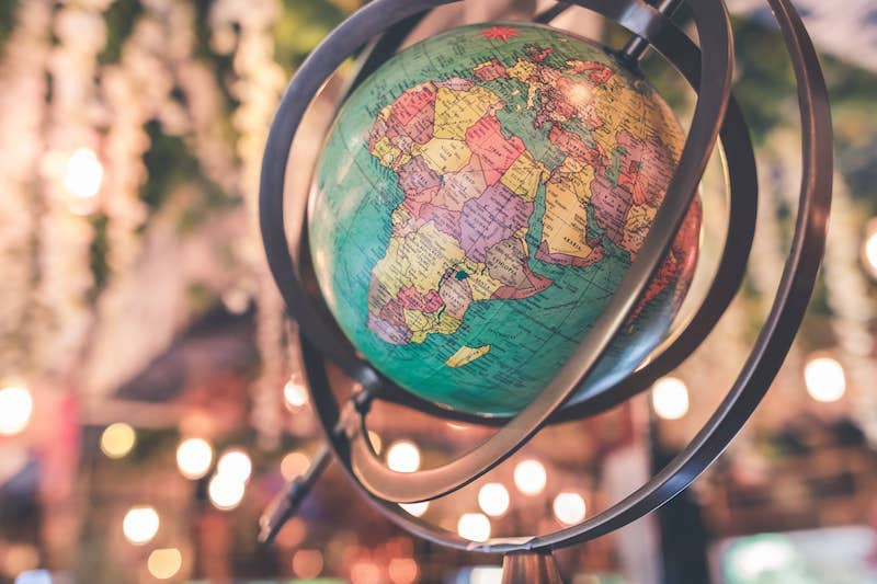 Globe representing housewarming traditions from around the world