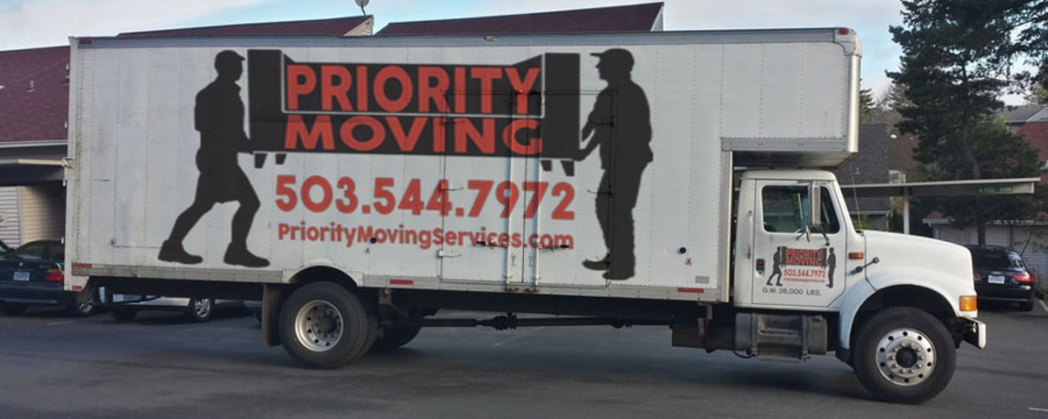 Priority Moving Services truck with logo and 503.544.7972 phone number