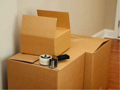 Moving boxes and packing tape roll