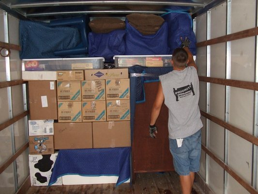 Priority mover organizing and packing a moving truck