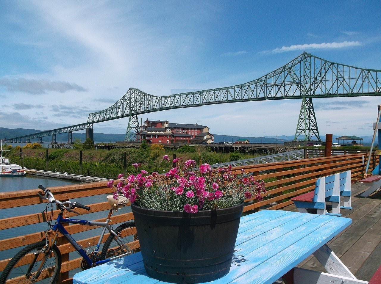 View of the Astoria–Megler Bridge with flowers and bike