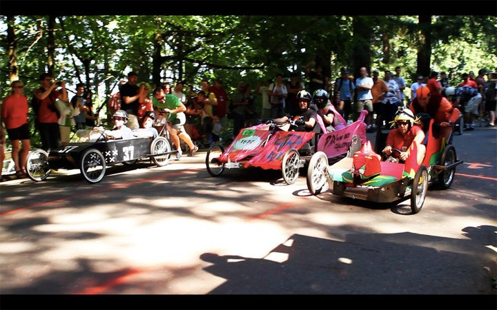 Adults racing in Mt Tabor Soap Box Derby